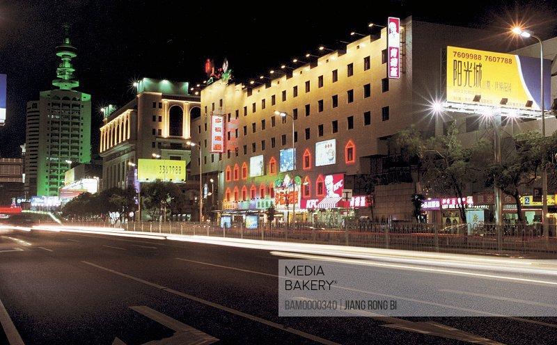 Illuminated buildings by road, Night scenery of Wuyi road, Fuzhou City, Fujian Province, People's Republic of China