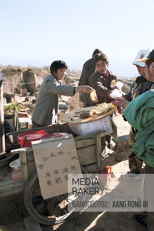 Peddler Selling North Shanxi Snacks , Yichuan County, Yan'an City, Shanxi Province, People's Republic of China