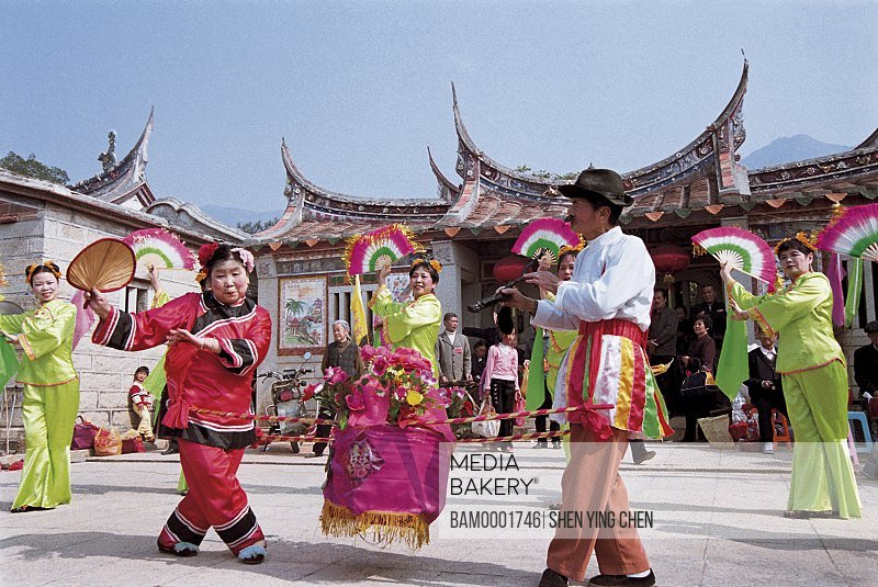 People performing at fair, Mountain temple fair performance of Beichen---Scolds the matchmaker, Beichen Mountain, Tongan County, Fujian Province of People's Republic of China