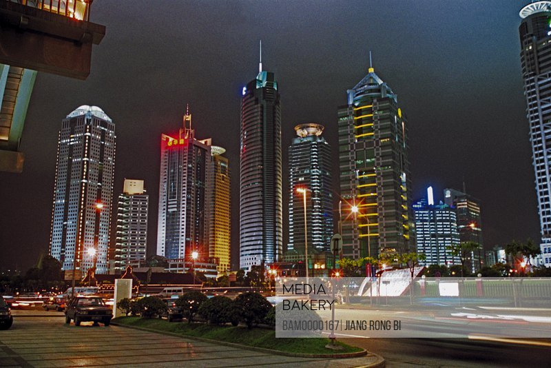 Low angle view of buildings at night, The night sight of banking cente of Pudong, Shanghai City of People's Republic of China