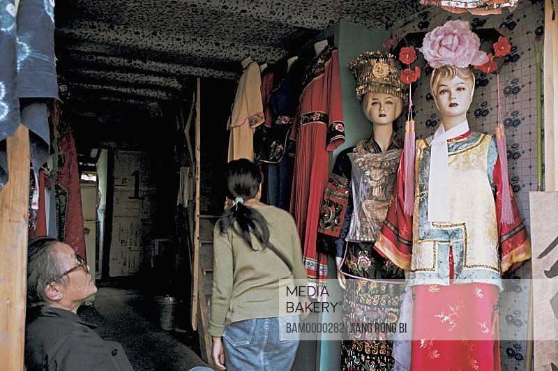 Mannequins by shop entrance, The clothes store in the old city, Fenghuang, Xiangxi Prefecture, Hunan Province, People's Republic of China