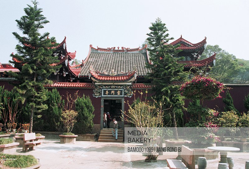 People entering the temple with Chinese text on entrance, Yunmen Temple Built in Song Dynasty , Changle City, Fujian Province, PRC