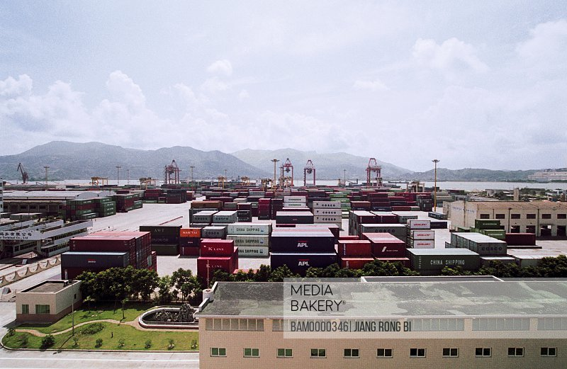 Elevated view of shipping containers with mountains in background, Shipping container wharf in Baoshui district in Mawei, Mawei District , Fuzhou City, Fujian Province, People's Republic of China