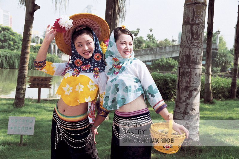 View of a cheerful teenage girls standing together, Hui'an women at the photographic exhibition often Taiwan strait, Fuzhou City, Fujian Province, People's Republic of China