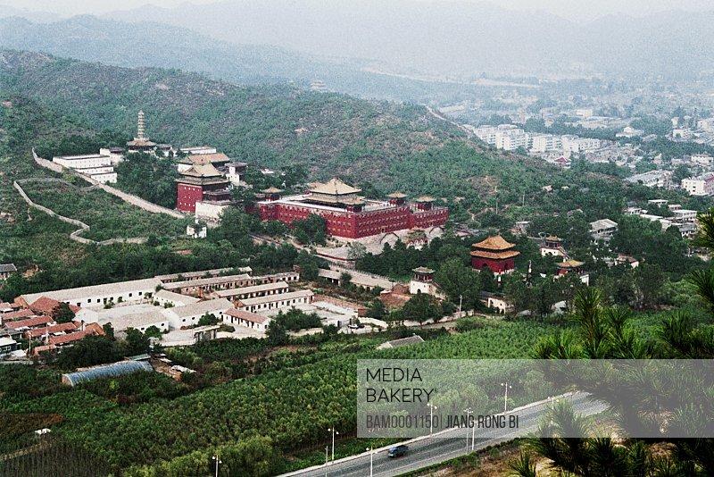 Elevated view of city with greenery, The whole scenery little Potala Palace, one of the Outside Chengde Eight Temple, Chengde City, Hebei Province of People's Republic of China