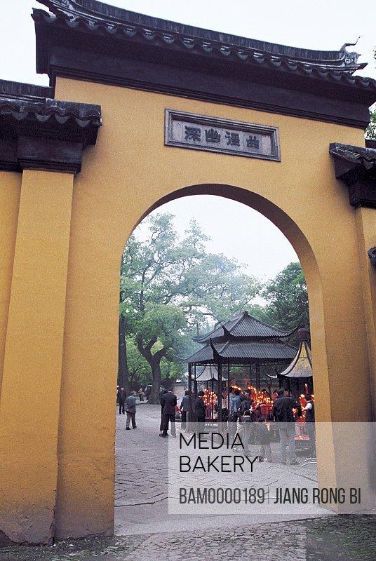 Tourists standing by entrance of wall, The gate of Xuanmiaoguan in Suzhou, Suzhou City, Jiangsu Province of People's Republic of China