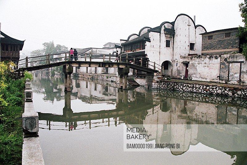 View of tourists on bridge over a canal, The old house of Nanxun, Nanxun Town, Huzhou City, Zhejiang Province of People's Republic of China