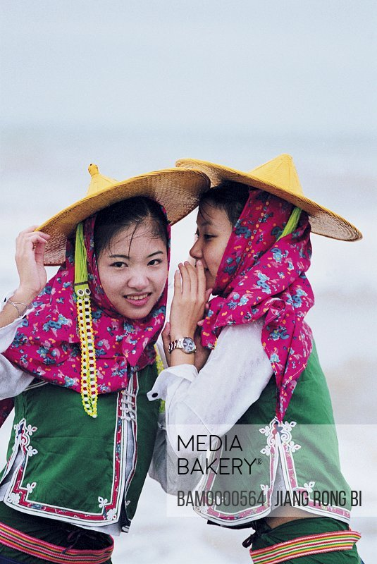 Girl whispering in other girl's ear at beach, Attractive Huian Ladies on Beach, Chongwu Town, Huian County, Fujian Province, People's Republic of China