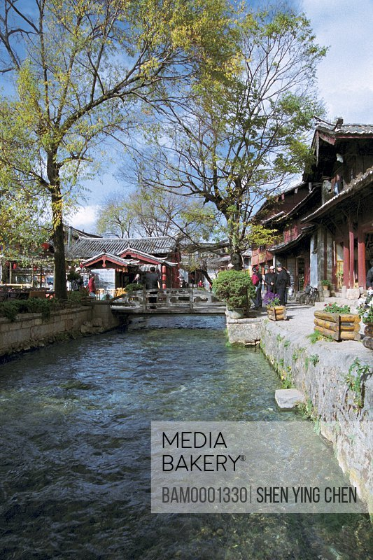 Stream amid shops, Historic building of old Lijiang city, Lijiang old city, Yunnan Province of People's Republic of China