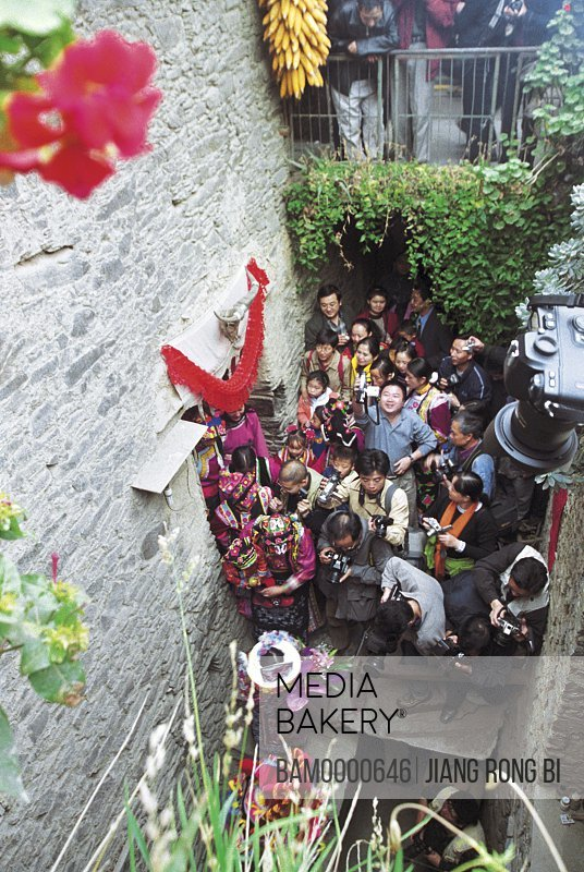 Qiang minority people near a wall, The Qiang minority people marry his wife, Li County, Aba State, Sichuan Province of People's Republic of China