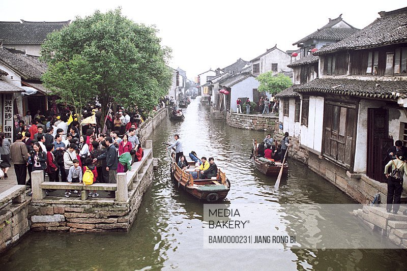 Elevated view of tourists traveling in boats, Crowded-visitor's Zhouzhuang region of rivers and lakes pond, Zhouzhuang Town, Kunshan City, Jiangsu Province of People's Republic of China