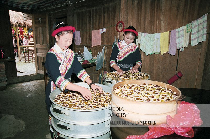 View of young women working in house, She race custom performance in the folk custom character and style garden, Rixi Township, Jinan District, Fuzhou City, Fujian Province of People's Republic of China