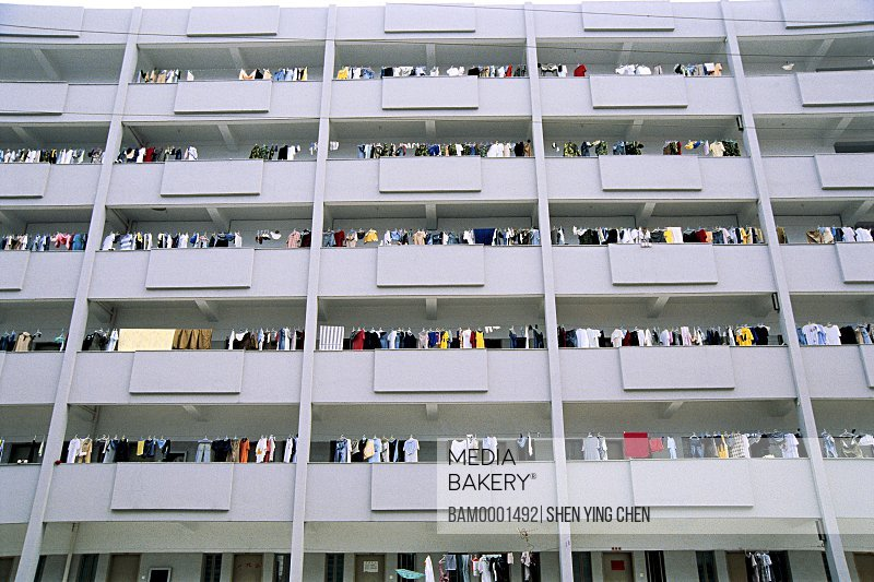 Low angle view of a building with clothes hanging in a balconies, Student apartment of Huaguang University, Quanzhou Hua Guang photographs art academy, Fujian Province of People's Republic of China