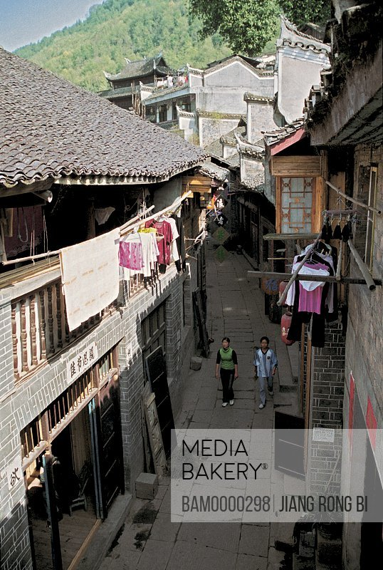 Elevated view of women walking on old street, The old street in the city of Fenghuang ancient city, Fenghuang, Xiangxi Prefecture, Hunan Province, People's Republic of China