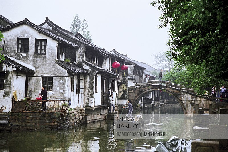 View of a boat in canal, The scenery of bridge of Zhouzhuang region of rivers and lakes pond, Zhouzhuang Town, Kunshan City, Jiangsu Province of People's Republic of China