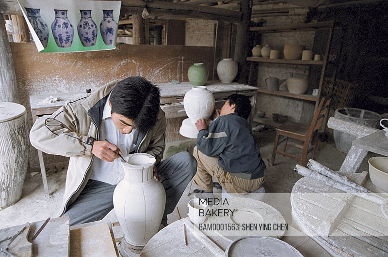 Worker drawing in the ancient kiln workshop, Jingde Town Ancient kiln, Jiangxi Province of People's Republic of China