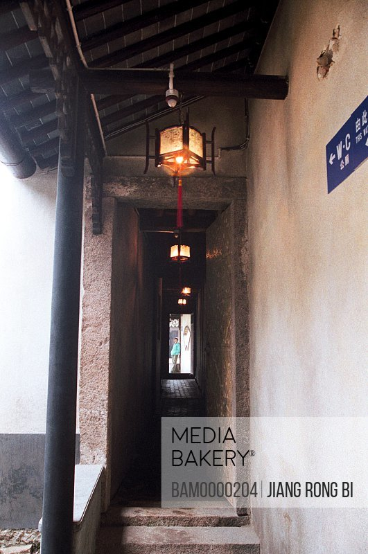 Person standing by porch of narrow lane, The porch in the historic building of Tongli, Tongli Town, Wujiang City, Jiangsu Province of People's Republic of China