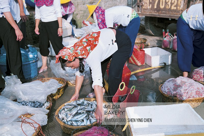 Huian Women in Xiaozuo Village are selling fish, Xiaozuo Village, Huian County, Fujian Province of People's Republic of China