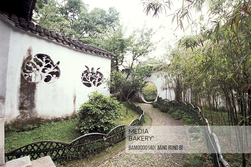 Walkway amid trees and walls, The gardens in Lingyan Mountain in the old town Mudu, Mudu Town, Suzhou City, Jiangsu Province of People's Republic of China