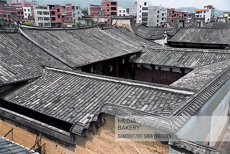 Elevated view of roofs with buildings in background, Building frame of Great Lin places, Great Honglin Places, Mingqing County, Fujian Province of People's Republic of China
