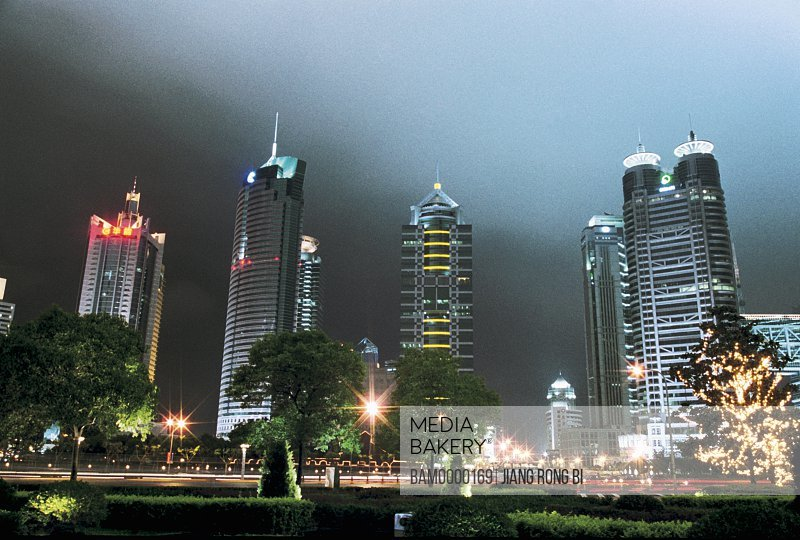 Low angle view of buildings at night, The night sight of banking center of Pudong, Shanghai City of People's Republic of China