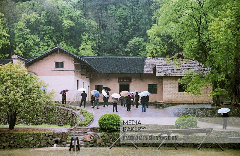 View of people standing by house, Shaoshan Mao Zedong former dwelling, Xiangtan City, Hunan Province of People's Republic of China
