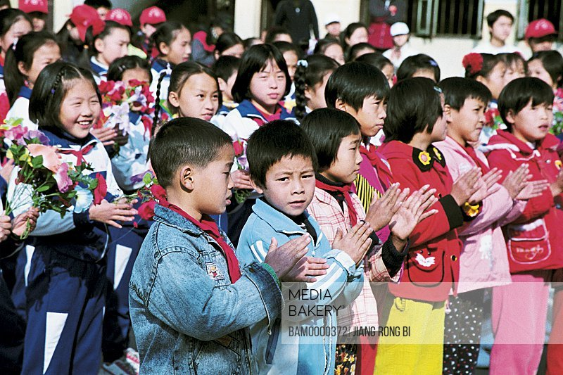 Portrait of children clapping, The students of central primary school welcome guests of school, Yongtai County, Fuzhou City, Fujian Province, People's Republic of China