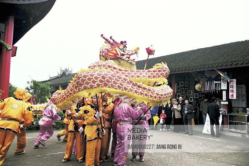 People watching dragon dance performance of Zhouzhuang's south lakefront, Zhouzhuang Town, Kunshan City, Jiangsu Province of People's Republic of China