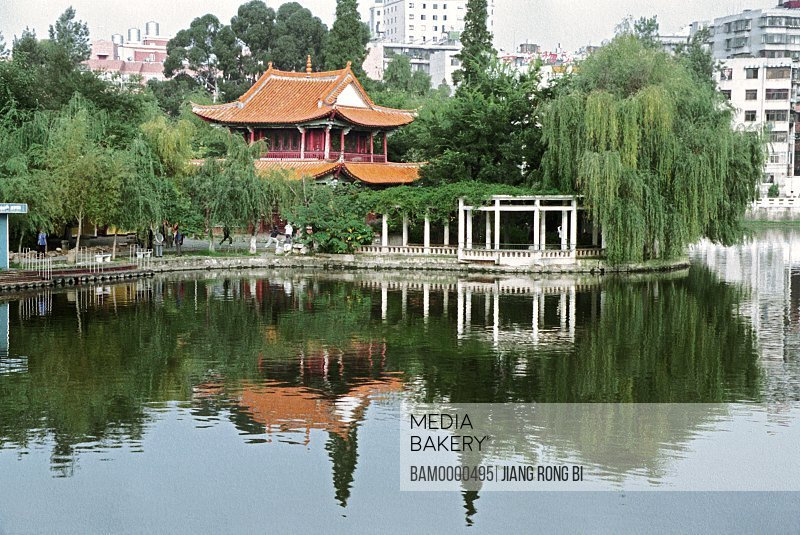 Reflection of structure and trees in lake, Scenery of Cuihu Park, Kunming City, Yunnan Province, People's Republic of China