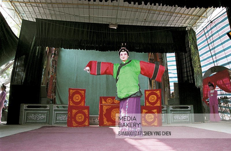 View of a puppet show at fair, Mountain temple fair performance of Beichen--Gaojia Drama, Beichen Mountain, Tongan County, Fujian Province of People's Republic of China
