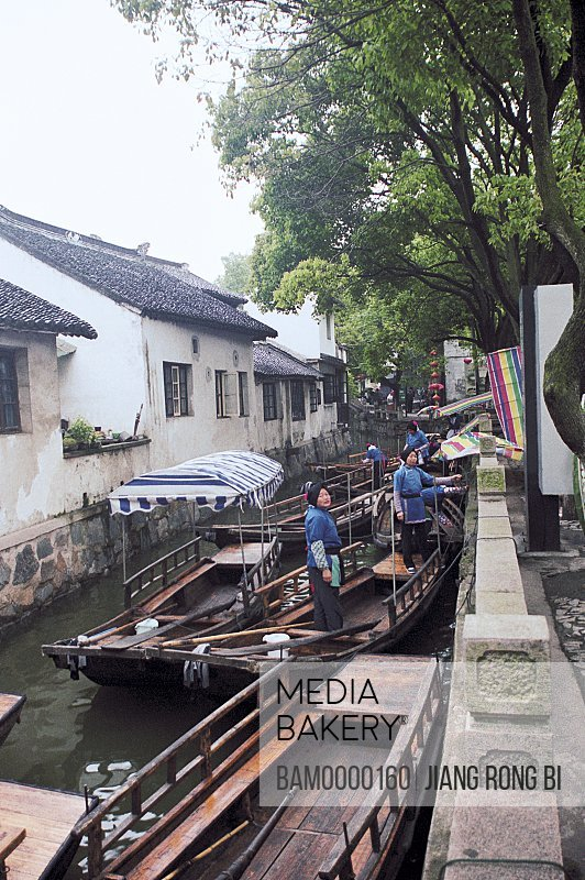 View of women in boats, The yachts of Jiaozhi region of rivers and lakes pond, Jiaozhi Town, Kunshan City, Jiangsu Province of People's Republic of China