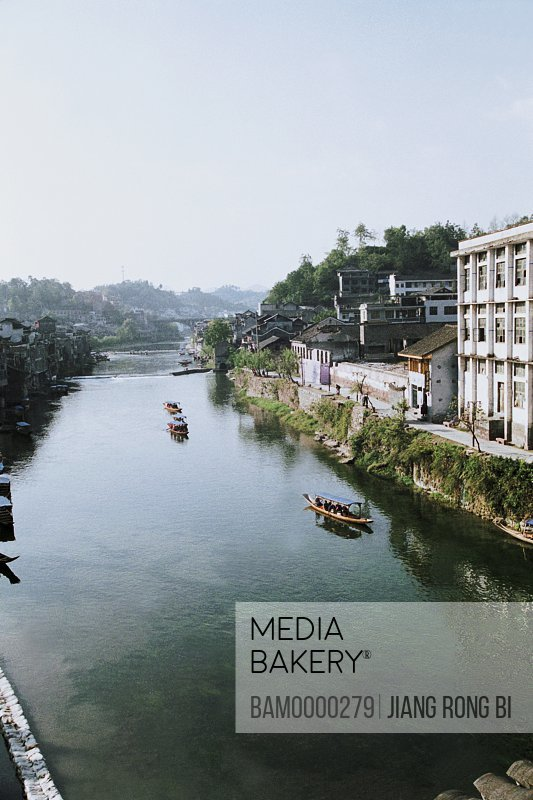 Elevated view of boats in river, The scenery of the Tuo River, Fenghuang, Xiangxi Prefecture, Hunan Province, People's Republic of China