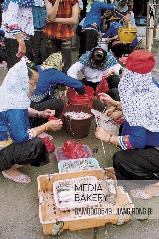 People buying fish in the market, Free Market of Xiaozuo Village, Chongwu Town, Huian County, Fujian Province, People's Republic of China