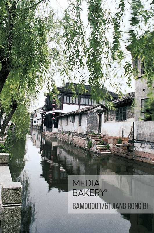 View of a house by river, Scenery of Xitang Town, Jiaxing City, Zhejiang Province, People's Republic of China