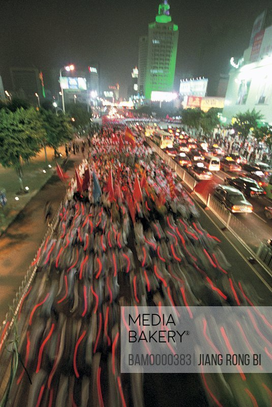 Elevated view of flags and automobiles on roads at night, Celebrate the chinese communist party the torch of forth national congress parade, Fuzhou City, Fujian Province, People's Republic of China