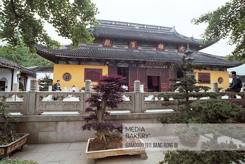 View of men sitting by a monument, Sakyamuni valuable palace in Xuanmiaoguan of Suzhou, Suzhou City, Jiangsu Province of People's Republic of China