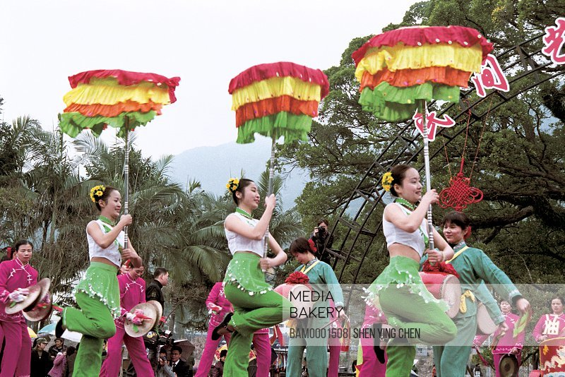 Men and women in traditional costumes performing on stage during a festival, Winter jasmine folk art performance in country forest park---On the shoulder plays, Fuzhou City, Fujian Province of People's Republic of China