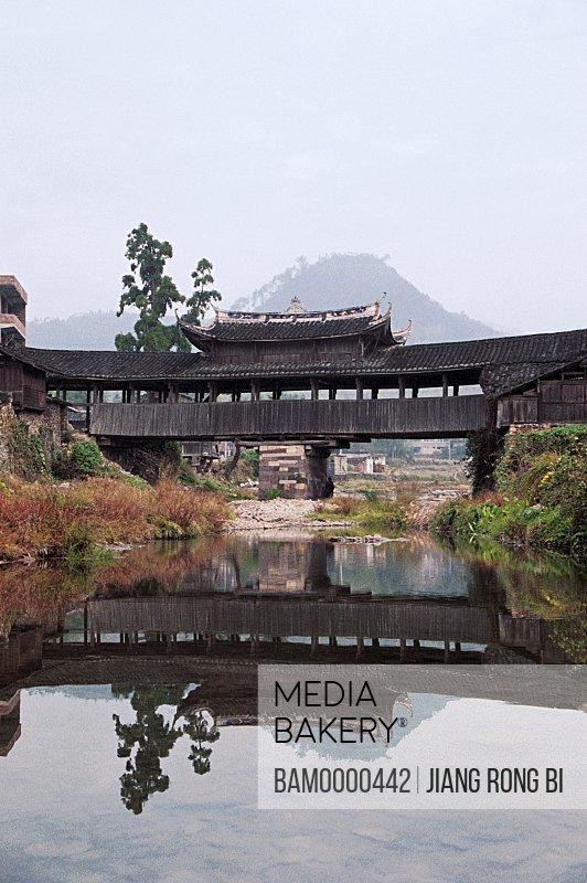 Lake by structure with mountain background, Yongqing Bridge Built in Qing Dynasty in Taishun, Taishun County, Zhejiang Province, People's Republic of China