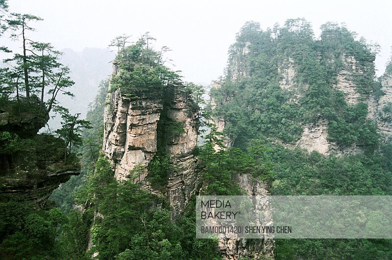 Mountains with trees against sky, Shizhai scenery of the Zhangjiajie, Zhangjiajie City, Hunan Province of People's Republic of China