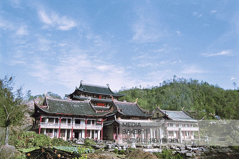 View of houses with mountains in the background, Guoxingchan temple of Taimu moutain, Taimu Mountain, Fuding County, Fujian Province of People's Republic of China