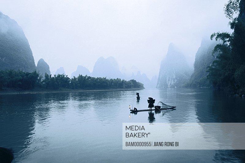 Man fishing on Li River, Yangshuo County, Guilin City, Guangxi Zhuang Nationality Autonomous Region of People's Republic of China