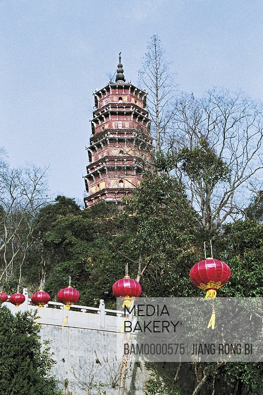 Low angle view of tower amid trees with lanterns in foreground, Hongshan Tower of Baotong Temple, Wuhan City, Hubei Province, People's Republic of China
