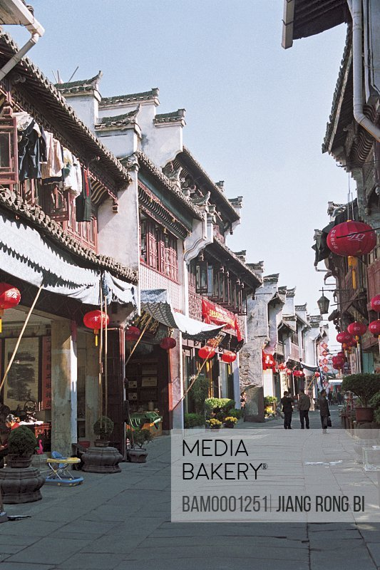 People at market decorated with Chinese lanterns, Old Street in Tunxi, Yixian County, Anhui Province, PRC