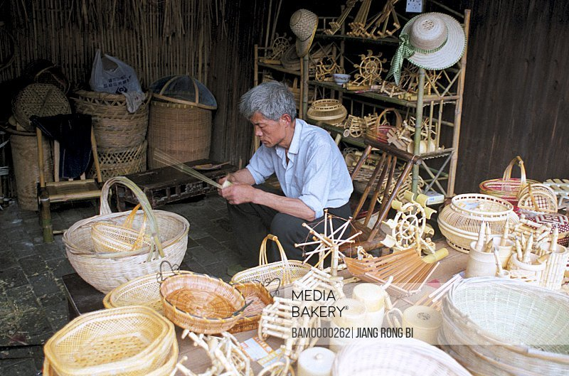 Senior man working in bamboo workshop, Wuzhen Town's Workshop for Bamboo Products, Tongxiang City, Zhejiang Province, People's Republic of China
