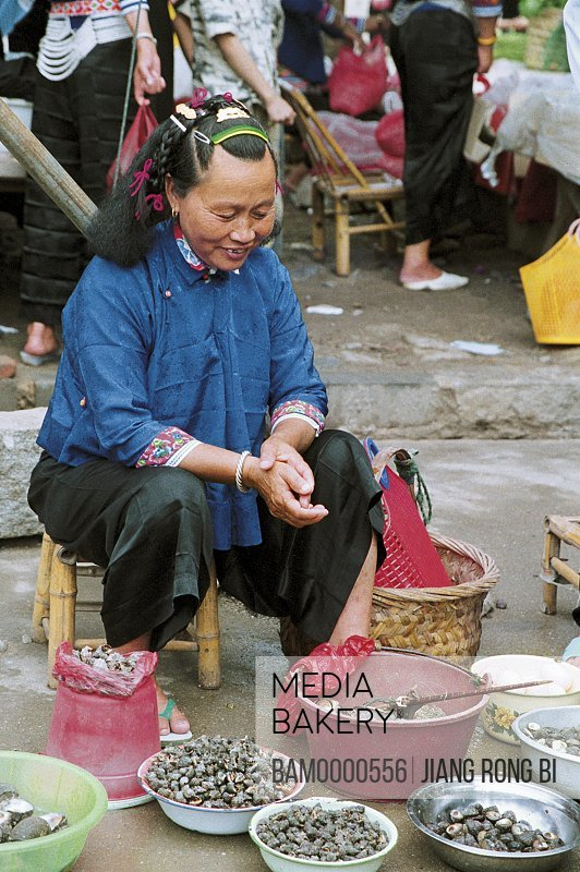 Huian Lady Selling Sea Snail on Free Market, Chongwu Town, Huian County, Fujian Province, People's Republic of China