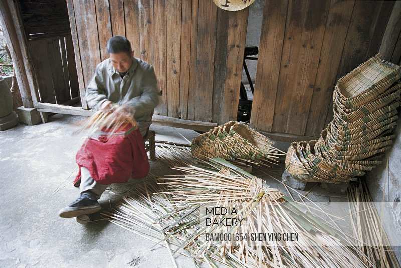 Man making wicker basket, Entertainer arranges the bamboo basket of Lu Village, Lu Village, Yi County, Anhui Province of People's Republic of China