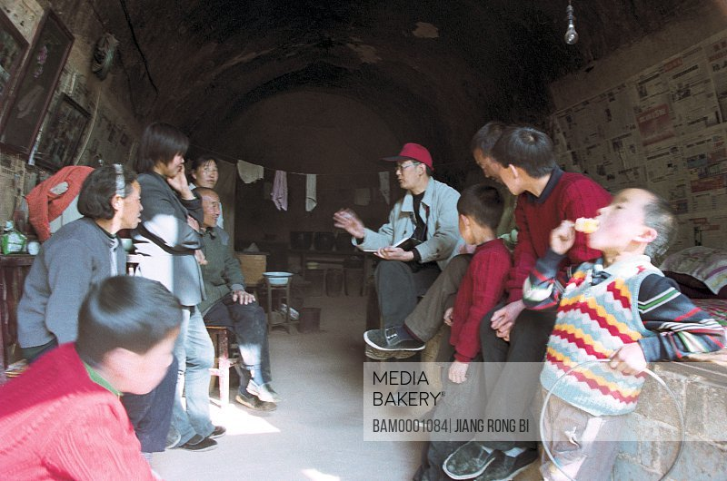 Cadres Talking to Villagers from Chenjiazhuang Village, Yichuan County, Yan'an City, Shanxi Province, PRC