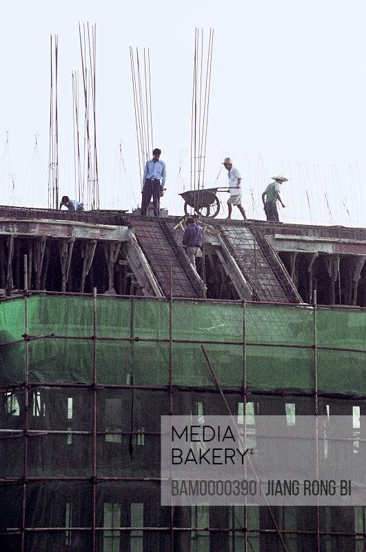 Laborers working at construction site, Fuzhou City, Fujian Province, People's Republic of China