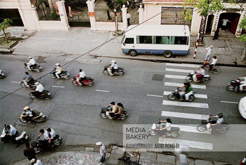 Elevated view of motorbikes on street, Hanoi City, Vietnam