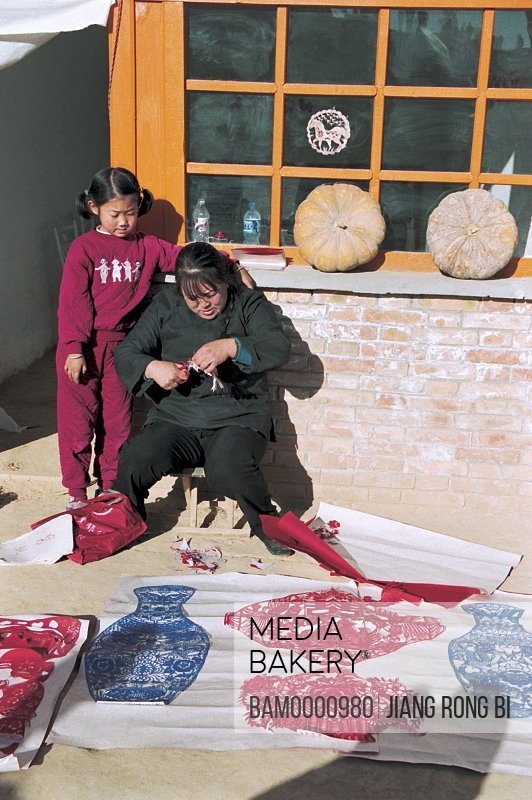 View of a mother sitting with daughter, Local Paper-cut of North Shanxi, Yichuan County, Yan'an City, Shanxi Province, People's Republic of China